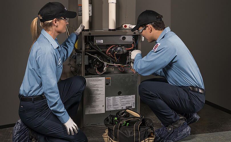 Service Experts working on a furnace